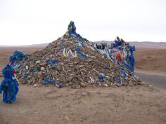 Ovoo is a sacred cairn found in Mongolian shamanic religious traditions