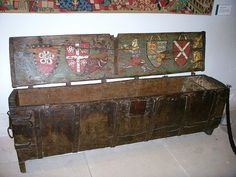 De Bury Chest overall: 635 mm x 1942 mm x 407 mm Glasgow Museum, no. 14.352 This very rare oak and iron chest, dating from around 1340, has painted decoration on a heraldic theme inside its lid. The decoration consists of four armorial shields flanked by a lion, a dragon, and a hybrid half man/half animal. The armorials relate to two families, D'Aungervile and Nevill, and one for England quartered with France. The chest originally belonged to Richard de Bury, Bishop of Durham from 1334–45, a…