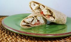 Mediterranean Chicken Wraps: roasted garlic hummus, tangy, salty Feta, juicy tomatoes and herb-coated chicken, all wrapped up a tasty, low carb tortilla. Just 286 calories or 8 Weight Watchers points per wrap! www.emilybites.com #healthy