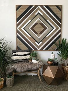 This piece is made with wire brushed white oak. With varying hues of grays, browns and a complimenting black and white, this piece embodies a warm, clean look all in one. In the photo the piece is 48 by 48 inches, but can be ordered in the sizes listed below. 30x30 inches -$295