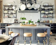 What really caught my eye was that the open shelves are in reality pieces of furniture that have been suspended on the wall. Great idea!