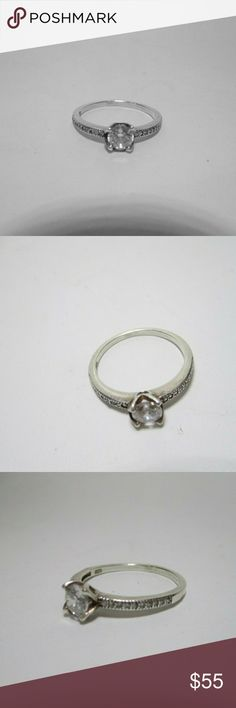 1/2 C CZ promise ring set in Sterling Beautiful  litely used Condition, size 7 Jewelry Rings