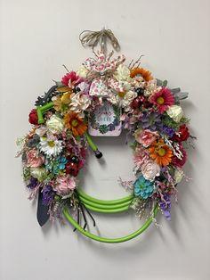 Water hose gardening wreath Water Hose, Floral Wreath, Gardening, Wreaths, Flowers, Gifts, Home Decor, Floral Crown, Presents