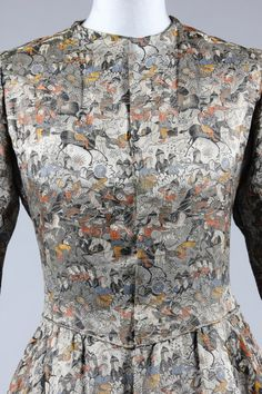 """A Paul Poiret """"Patineur"""" brocaded satin evening gown, the fabric designed by Raoul Dufy for Bianchini Ferier - """"Chasse Persane"""" [detail showing Persian hunters], 1921. Kerry Taylor Auctions."""