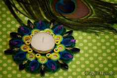 precious peacock-This collection is inspired by nature!! Our choice of color, embellishment & design is pre dominantly Indian.These water resistant quilled candle holders are great option They make good decorative item or you can just pick them for gifting..Each one is handmade by using paper strips, quilled to get desired designs.  www.facebook.com/craftstruck  craftstruck2012@gmail.com  #quilledart #quilling #quilledcandles #quilledtealightcandle #craftstruckdesignstudio #quilledhomedecor