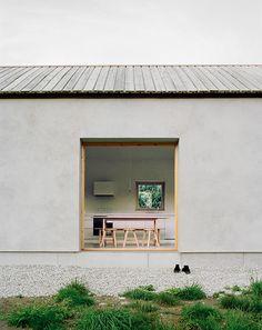 Gravel around perimeter natural wood window trim