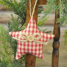 Every tree needs a star at the top!. The Red Gingham Stuffed Star is accented…