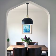 Simple guide to styling a dining room with dining room lighting, art & timeless furniture