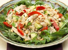 Warm Brown Rice Chicken and Arugula Salad  Great salads don't have to be cold. Enjoy this warm, hearty salad of brown rice, chicken, arugula, red pepper and Girard's® Champagne Dressing.   From Marzetti Kitchens℠.