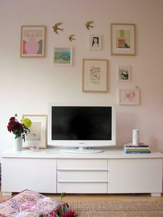 gallery wall above the tv. great way to fill up all of that unused wall space! cute placement