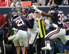 Chicago Bears cornerback Tracy Porter (21) intercepts a pass intended for Houston Texans wide receiver DeAndre Hopkins (10) during the first half of an NFL football game Sunday, Sept. 11, 2016, in Houston.