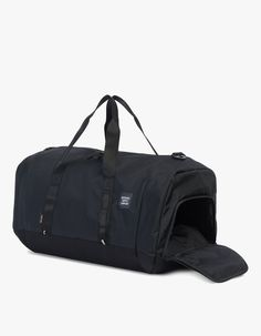 Duffle bag from Herschel Supply Co. Available in Black or Moonstruck. Two-way waterproof zipper with Prusik cord pulls. Reinforced webbing carry handles with multi-loop stitch detail. Zippered side pocket with webbing utility handle. Removable padded webb