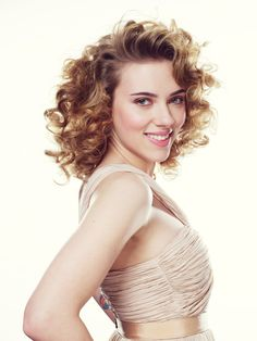 Scarlett Johansson  has enhanced her boobs and hair  as you can see just a few years ago  wasn't so va va voom