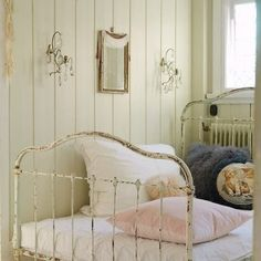 I love the beauty of old, white, iron beds