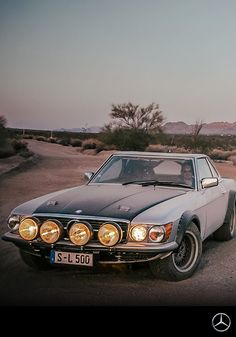 This older-model Mercedes-Benz goes on an expedition in the California desert. Sand, dust, and pebble stones make up the Joshua Tree National Park, which adds to the exciting, spectacular drifts.
