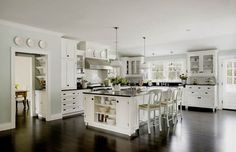 white cabinets, black counters