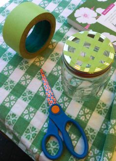 6_26_13_mason_jar_flower_arranging. Make a grid with masking tape to keep taller flowers upright.