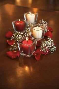 Centerpiece needs to be spiced up with a little bit more glam but a cheap idea when it comes to the candleholders