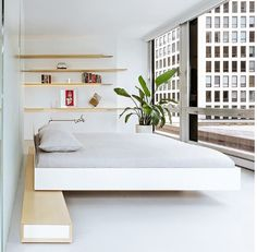 A floating bed inside a renovated unit in Mies van der Rohe's iconic 860-880 Lake Shore Drive. Do we need to say more? #lessismore #miesvanderrohe #architecture