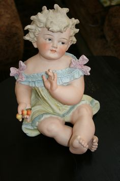 one of two large piano babies by Conta Boehme  http://www.ebay.com/itm/RARE-MINT-Lg-11-Antique-Conte-Boehme-German-Bisque-Piano-Baby-Girl-/331269908775?ssPageName=STRK:MESE:IT