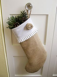 love this burlap stocking with greens and pinecones!