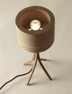 """headandhaft: """" """" NEW Minus table lamp.Lamp arm constructed from one piece of cornish air dried oak, split and bent into the form of the legs. The shade is solid agglomerated cork. The process was..."""