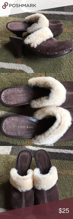"Gianni Bini clogs🌺 Style is ""Furrever""🌺 leather upper man-made lining man-made sole 🌺wood clog with brass tone hardware 🌺made in Brazil 🌺 heel measures approx 3"" 🌺good used condition 🌺some wear to right top faux fur Gianni Bini Shoes Mules & Clogs"