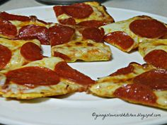"""Ginny's Low Carb Kitchen: THIN CRUST PIZZA CRUST. """"I make this pizza for a quick lunch pizza quite often and I've also made it into a larger pizza on pizza night at our house. It's become my favorite pizza crust. Even my non-low-carbing hubby says it is good. It's quick and easy to put together. I always make it in my toaster oven."""""""