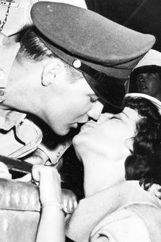 Elvis Presley kissing fanLillian Portnoy at theBrooklyn Army Terminal before sailing to Germany, September 22, 1958.