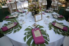monstera leaves with pink mokara orchid centerpieces stargazer
