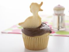 Classic Yellow Cupcakes with Milk Chocolate Frosting and duck cookie    Top off yellow cupcakes with classic chocolate frosting, then finish with an adorable duck-shaped cutout.
