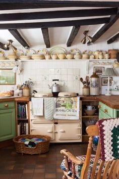 I love the green color, the stove, the rocking chair being in the kitchen
