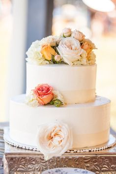 Wedding Cake - simple, but beautiful with what appear to be a few real flowers...something like this for cutting, cupcakes for EATTING!