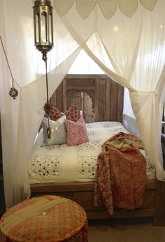 A dreamy bedroom with Moroccan and Bohemian inspirations. I love the canopy over the bed and the lantern. Romantic touches.