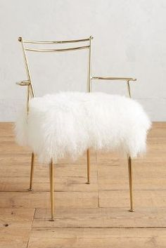 Anthropologie shag puff dressing chair on ShopStyle