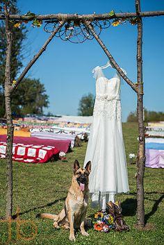Rustic outdoor wedding with the couple's German Shepard protecting the wedding details. TBD Photography - Nebraska Wedding Photographer