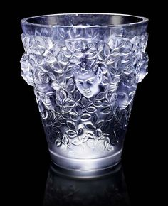 René Lalique 'Silènes' a Vase, 1938, frosted and polished glass, heightened with grey staining, via Bonhams.