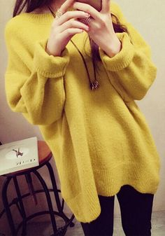 Add a cheer vibe to your outfit by wearing this yellow oversized knit sweater. It's styled with a crew neckline and ribbings for that snug fit perfect for the sweater weather. | Lookbook Store