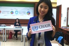 This was taken during a STMUN debate break. Sam and I were playing at being the chairs, so she held up the placard. Sam is directly on the rule of thirds line. I used a high aperture with a low f value to make the background very blurry. I was standing, but Sam is taller than me, so she had to look down a bit. I like how this picture shows the fake-chairing moments Sam and I had, how the delegate of Luxembourg was very hardworking, and the layout of the Security Council. This photo has a…