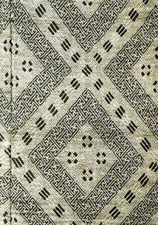 From Min Gei Kan: Japanese Kogin Meiji Period, 19th Century - Originally kogin was used as a form of darning or reinforcing work clothes. The patterns became more beautiful and were known for their intricate designs. Kogin is most commonly done with white thread on an indigo blue background.