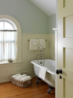 Cafe curtains ~ perfect for privacy yet allowing for a light filled bathroom!  Battle Associates Architects