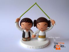 Made in clay and wood. Submit name and date of wedding at time of order for personalized base. Measures 3 high by 4 width.
