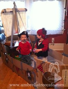 My boys in our first cardboard creation, a pirate ship.