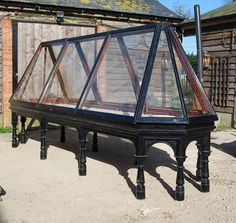 A late Victorian ebonised mahogany pyramid museum display case,