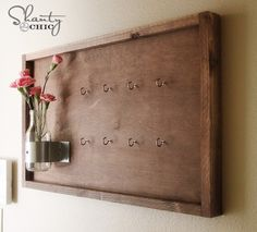 Decorate old wooden board with vase and flowers. Really cute key holders - 20 DIY Creative Key Holders