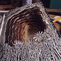 Isobelle Ouzman -- illustrated 3-D book sculptures