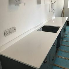 Installed A straight-forward installation of two straight runs of the Bianco Puro, pure white quartz. The kitchen design allows for a functional space, while the worktops compliment the dark teal coloured hand-made cabinets and doors. Worktop Ideas, Kitchen Worktop, White Quartz, Work Tops, Teal Colors, Pure White, Granite, Kitchen Design, Desk