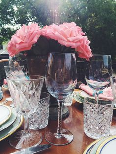 Romantic scenery. Pink roses bouquet, vintage cutlery. Romantic tabletop. Vintage, Bavaria porcelain plates and cristal glasses. Outdoor dinner.