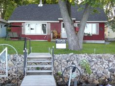 "N10552 Howard Ave Fox Lake, WI 53933 $186,900 Single Family Status: Active Bed:2 Bath:1 Sqft:840 WATERFRONT! Perfect turn-key RE-TREAT! Enjoy beautiful Fox Lake from your fully furnished 2 Bedroom, 1 Bath, move-in ready ""Year Round Cottage"". Offering 50 feet of private rip-rapped shoreline, house is accessible only by a private drive."