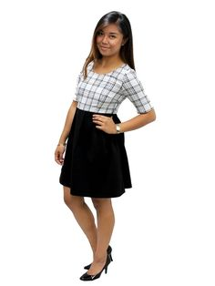 Everyone stresses the importance of dressing professionally when going in for a job interview, but no one ever said you didn't have to look good doing it! For your next big gig, put on this plaid and black dress for a classic, polished look that will impress your future boss. Featuring neutral colors, this dress allows you to let your personality and accomplishments be the star of the show. Pair with black heels or flats for a interview worth look!  Relished Exclusive Bodice: 84% Polyest...